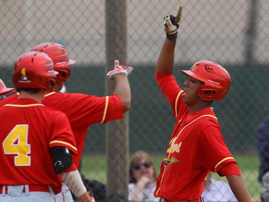 At far right, Jeremiah Estrada celebrates his three-run