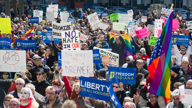 Thousands of opponents of Indiana's new religious freedom law protested in front of the statehouse in Indianapolis on Saturday.