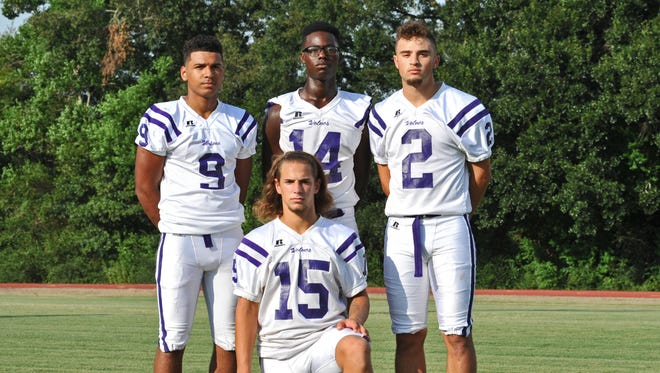 Rayne High's offensive backfield of Donald Doucet (15), running back Trent Winbush (9), running back Johnny Deculit (14) and receiver Jaylon Reed (2) all turned in big plays in the Wolves' 26-13 win over Leesville on Thursday.