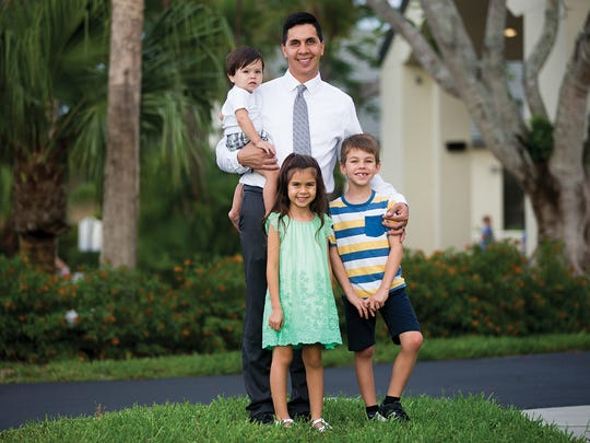 Austin Gomez with his three children: Carlos, 7, Evelyn, 5, and Christian, 1.