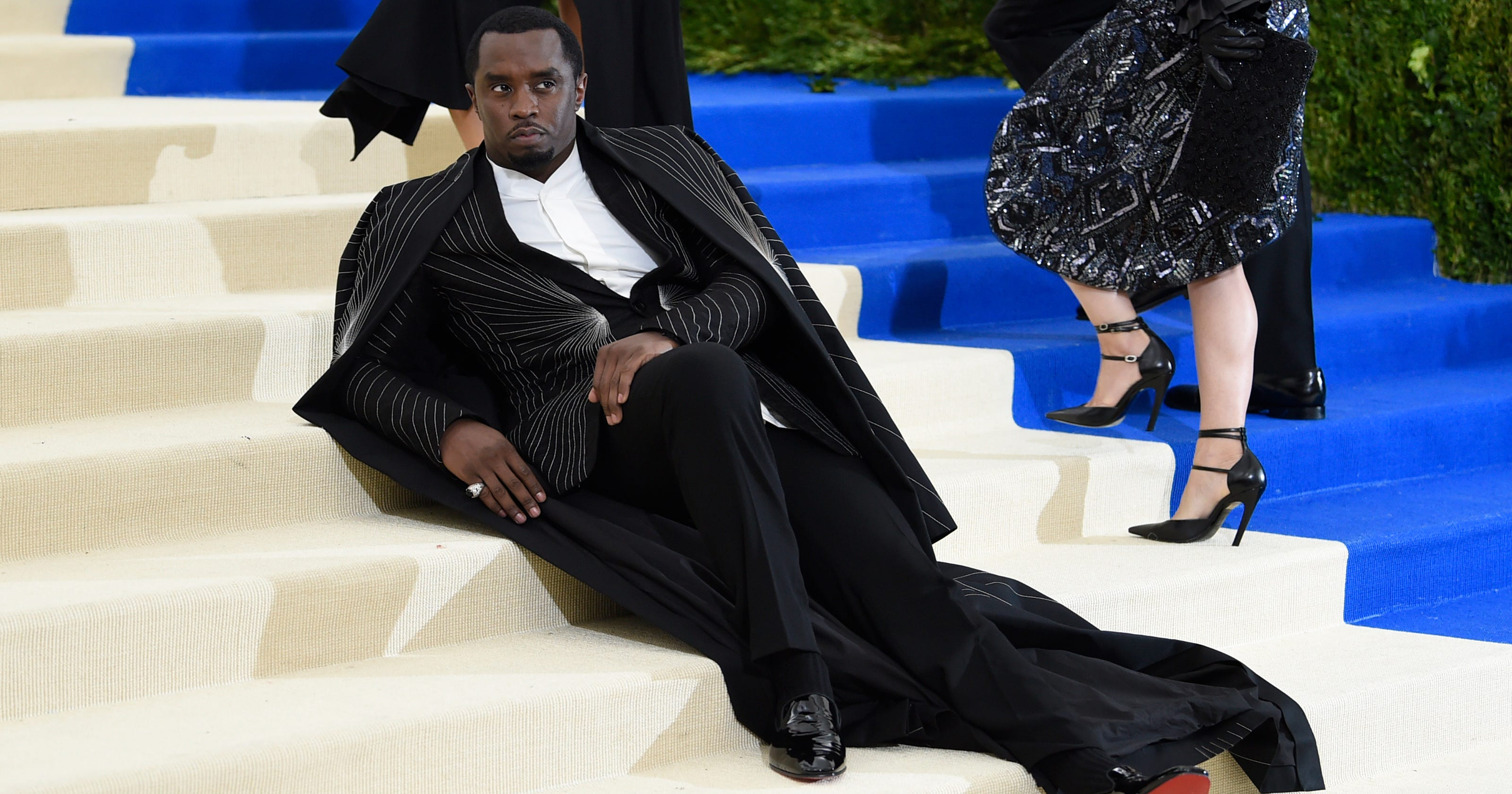 Tired' Sean 'Diddy' Combs laying on the Met steps is all of us