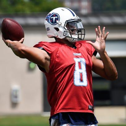 Titans quarterback Marcus Mariota (8) throws a pass
