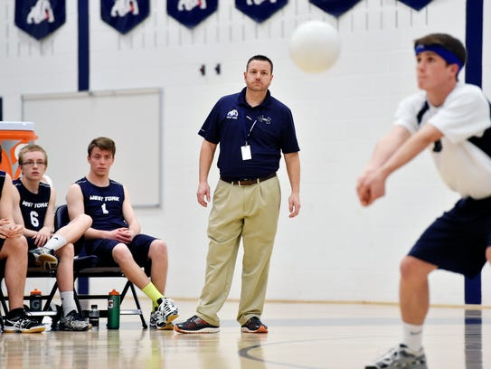 West York head coach Kevin Wolf watches as libero Josh