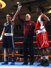Nevada's Nate Strother, left, defeats UCLA's Gabriel Samuels during the 2017 NCBA Western Regional Semi-Finals at the Eldorado Hotel & Casino in Reno on March 18, 2017.