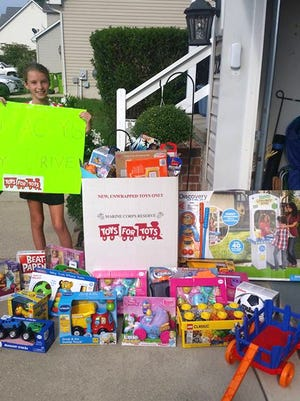 "Jordan O'Connor, 11, of Grasonville, Md., is pictured with toys - over 100 - that she and her family collected in the first Stacey's Toy Drive for Toys for Tots in Queen Anne's County, Md. Jordan is the niece of Stacey Seldomridge Pennington, who was killed in September 2015 outside her Mt. Gretna store. Lindsay Seldomridge O'Connor, Jordan's mother and Pennington's sister, wrote that Pennington was a huge supporter of Toys for Tots. ""For years, she collected toys in her stores and held fundraisers to raise money for this charity that was so very close to her heart,"" O'Connor wrote. Her family plans to make the toy drive an annual event to honor Pennington's legacy and to give back to the community in her name, making something positive out of a tragedy."