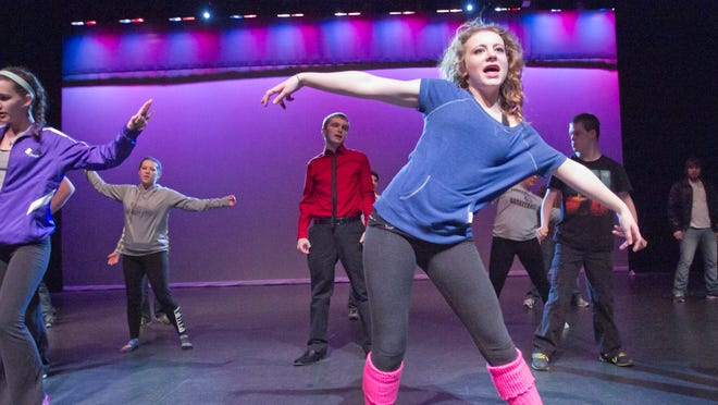 """Madison LeMieux, center, as Rusty, and fellow members of the Fowlerville Community Theatre rehearse a dance scene for their upcoming performance of """"Footloose."""""""