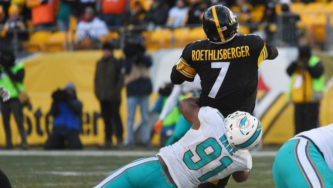 Steelers QB Ben Roethlisberger is hit by Dolphins DE Cameron Wake in Sunday's game.