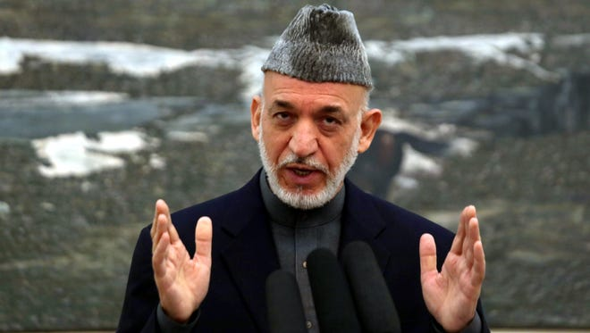 Afghan President Hamid Karzai speaks about the grand assembly of Afghan tribal elders during a news conference in Kabul on Nov. 16.