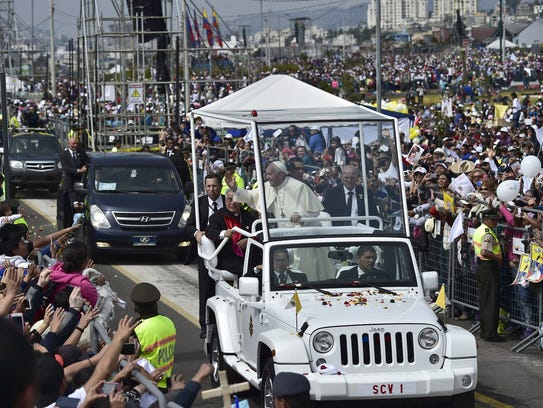 Pope Francis waves believers after an open-air mass