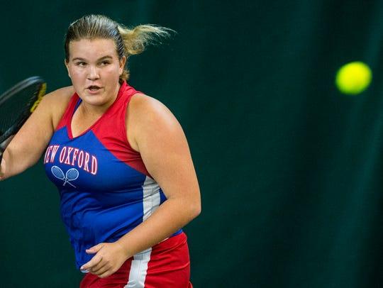 New Oxford's Kamdyn Balko returns the ball during her