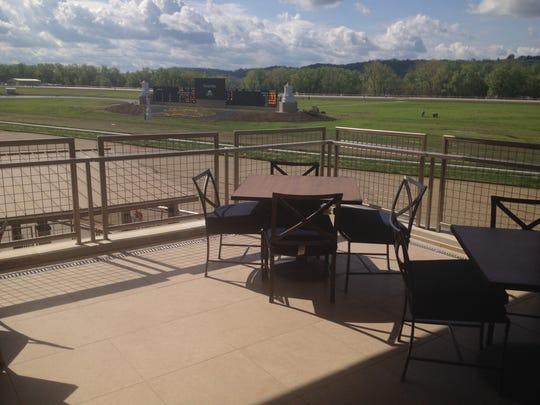 Get a table outside at Favorites at the new Belterra Park and you can eat caprese salad and steak and watch the ponies.