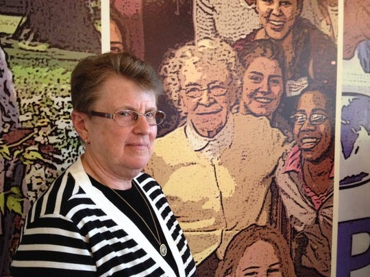 Sister Mary Jane Herb is the president of the Sisters, Servants of the Immaculate Heart of Mary congregation of Catholic nuns, based in Monroe. The congregation founded Bloomfield Hills Marian High School and Marygrove College in Detroit, as well as taught at scores of southeastern Michigan Catholic schools. She's standing in front of a mural at the IHM motherhouse which depicts Marian High School students surrounding a beloved longtime Marian math teacher and IHM nun, Sister Evangeline Nester who died at age 96 in 2012.