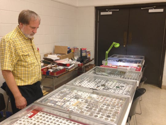 Jeff Starcher set up his coin display at the West Tennessee Collectors Club 55th Annual Coin Show.