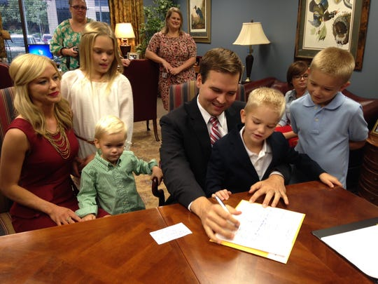 Zach Dasher (third from right), the nephew of 'Duck Dynasty' patriarch Phil Robertson, qualifies for the 5th Congressional District race on Thursday in Baton Rouge.