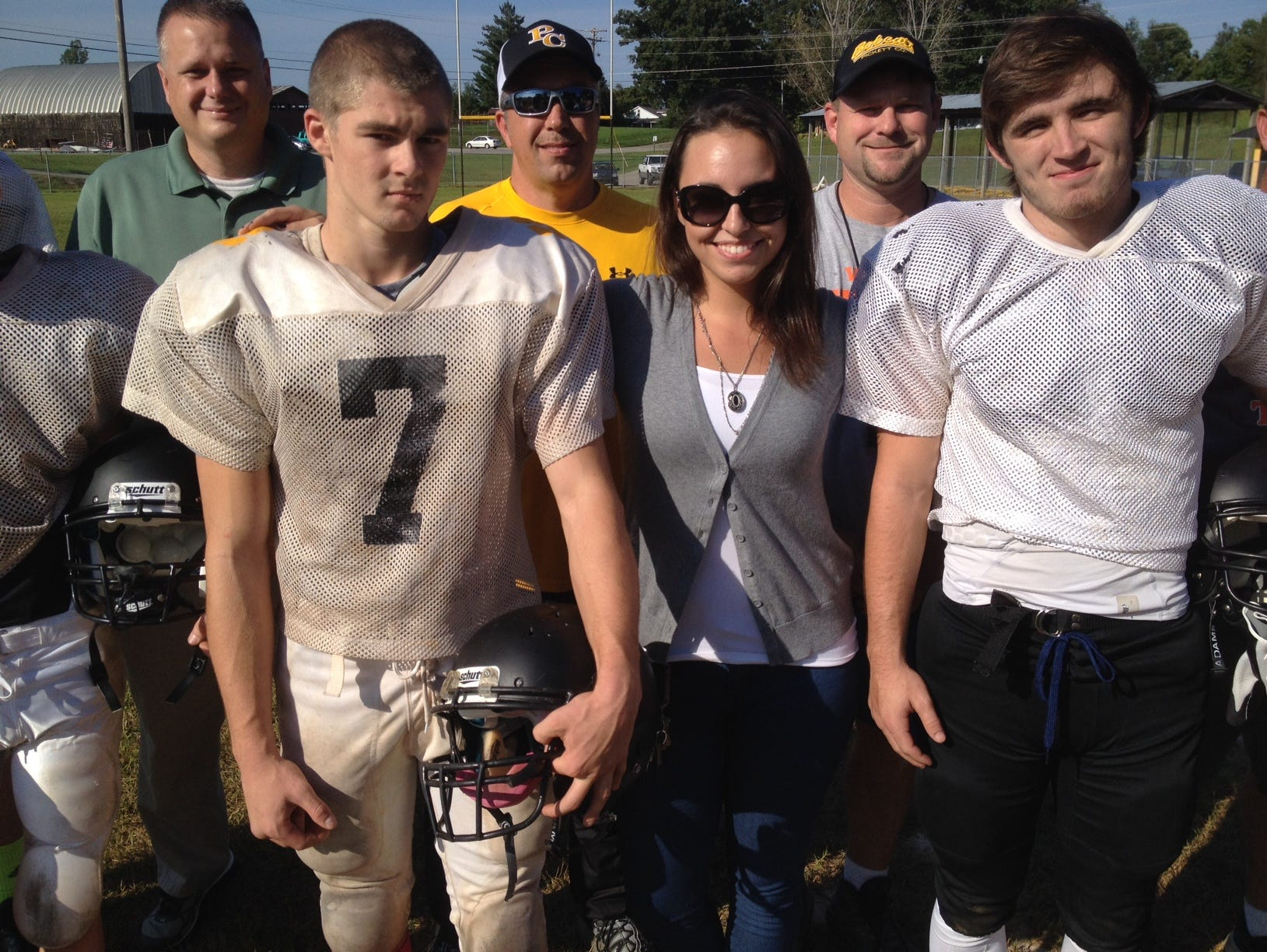 Brittney Garner poses with some of her Pickett County High football players Wednesday.
