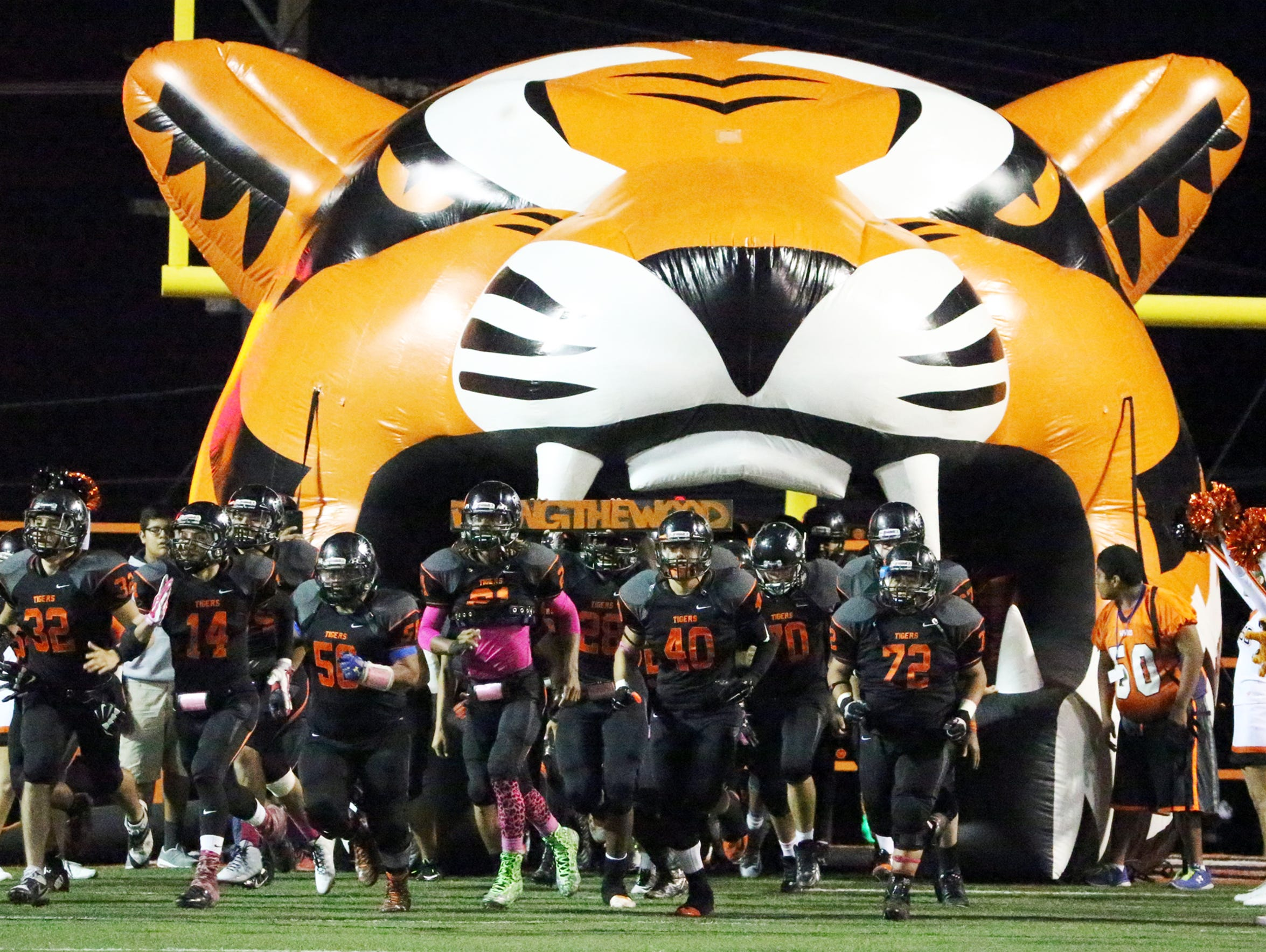 The El Paso High Tigers rush onto their home field