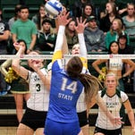 Colorado State freshman Alexandra Poletto (14) gets higher than everyone and drives a shot into the defense of San Jose State junior Allison Meehan (14) Wednesday night at Moby Arena.