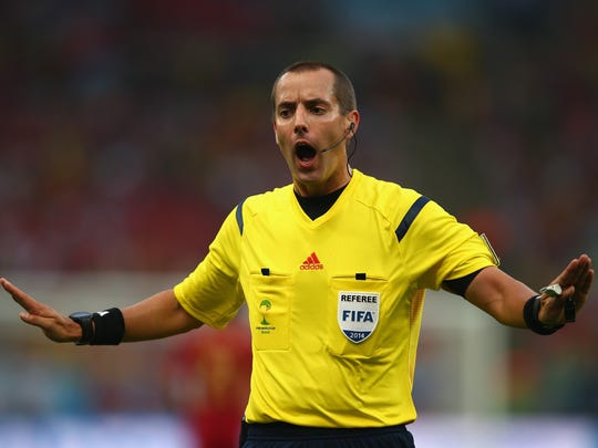 Referee Mark Geiger gestures during a World Cup match between Spain and Chile on June 18.