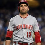 Cincinnati Reds first baseman Joey Votto (19) reacts after striking out against the Los Angeles Dodgers during a MLB game at Dodger Stadium.