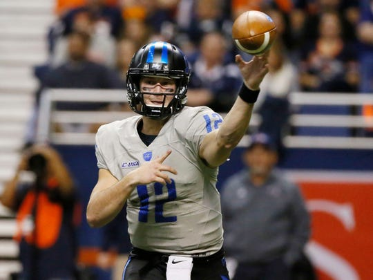 Blue Raiders quarterback Brent Stockstill (12) is learning more concepts under offensive coordinator Tony Franklin.
