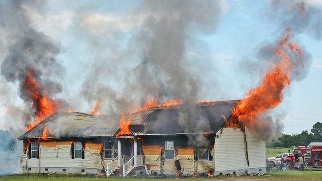This home on Minwood Lane was fully involved when firefighters arrived on July 15. The community has responded to help Melissa All and her children.
