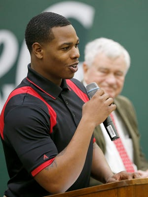 Andre Christopher, Cincinnati Reds RBI Alumnus, recounts his time as a player in the league during a press conference at the P&G Cincinnati MLB Urban Youth Academy in Cincinnati on Wednesday, Jan. 27, 2016, as Reds COO Bob Castellini looks on. The Reds and MLB announced Wednesday that the 2016 and 2017 RBI World Series youth baseball and softball event will take place in Cincinnati, including games played at Great American Ball Park.