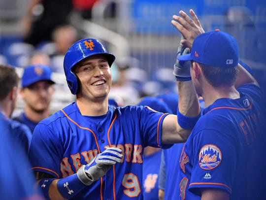 New York Mets left fielder Brandon Nimmo (9) celebrates