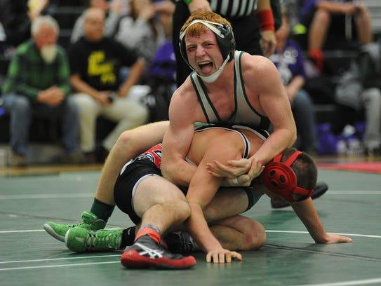 Madison's Kaleb Gibson struggles to control Ryan Hemmerly