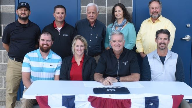 Mountain Home was officially named as the host of the 2018 Babe Ruth 13-year-old World Series at a contract signing Monday evening at McClain Park. Pictured are: first row, from left, Brad Coleman; Brandy Jordan of Mountain Home Youth Baseball; Robert Faherty Jr., vice president/commissioner of Babe Ruth League; Tom Czanstkowski of MHYB; second row, Curt Drewry; Andy Wescoat; Mountain Home mayor Joe Dillard; Angela Broome, executive vice president of the Mountain Home Area Chamber of Commerce; and Jeff Pipkin, president of the Mountain Home Area Chamber of Commerce.