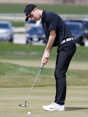 Lincoln's Kevin McMeans sinks his put at the Fox Hills Golf Invitational at the Fox Hills Resort National course Thursday, May. 4, 2017, in Mishicot, Wis. Josh Clark/USA TODAY NETWORK-Wisconsin