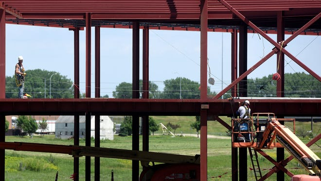 A construction crew works in June on the framing for the CarsForSale.com headquarters at Lake Lorraine. At $14.7 million, it's one of the city's biggest projects so far this year.