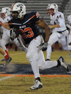 Blackman's Master Teague finds an opening on a kickoff return. Teague ran 28 times for 325 yards and three TDs in the Blaze win over Jefferson County.