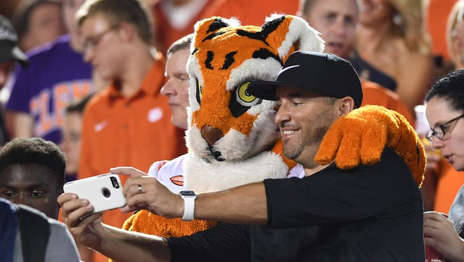 The Clemson Tiger poses for a photo with a fan during the 3rd quarter on Saturday, September 16, 2017 at Louisville's Papa John's Cardinal Stadium.