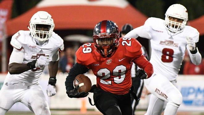Western Kentucky running back Jakiri Moses runs the ball against Florida Atlantic on Oct. 28 in Bowling Green, Kentucky.