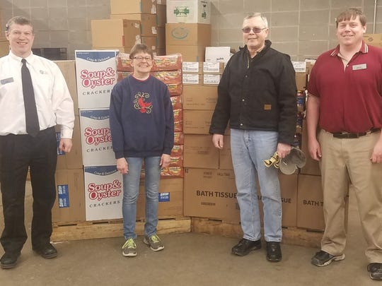 Fox's Piggly Wiggly of Two Rivers recently donated more than $750 worth of groceries to the Two Rivers Ecumenical Pantry. Funds were raised during the annual Christmas Ball Bonanza. Pictured, from left, are: Rob Ullman, Piggly Wiggly store manager; Lynn Skarvan, TREP coordinator; Paul Schmid, TREP vice president; and Brandon Schwake, assistant manager at Fox's Piggly Wiggly.