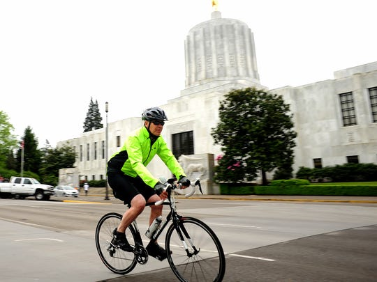 A rider takes off from in front of the Oregon Capitol during the 39th annual Monster Cookie Metric Century Bicycle Ride on April 26, 2015.