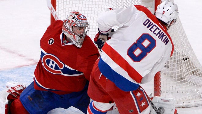 Montreal Canadiens goalie Carey Price stops Washington Capitals forward Alex Ovechkin during the shootout, but  Ovechkin scored twice in regulation.