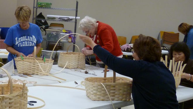 (From left) Rutgers' Master Gardeners Louann Winter, Mary Ellen Walker, Marianne Bagliani (in front) and Keiko Warner work on their market baskets during a workshop with Patti Heisler of Riverbend Basket Co.
