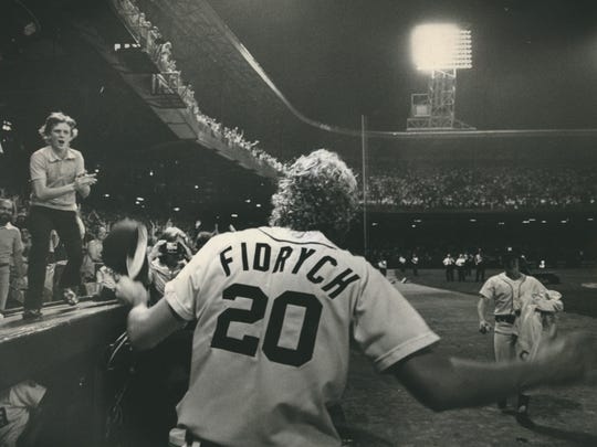 """Mark Fidrych answers cheering crowd of 47,853 at Tiger Stadium as he came back onto the field after the game to acknowledge their chants of """"We Want the Bird, We Want the Bird"""" after he stopped the Yanks, 5-1, on June 28, 1976."""