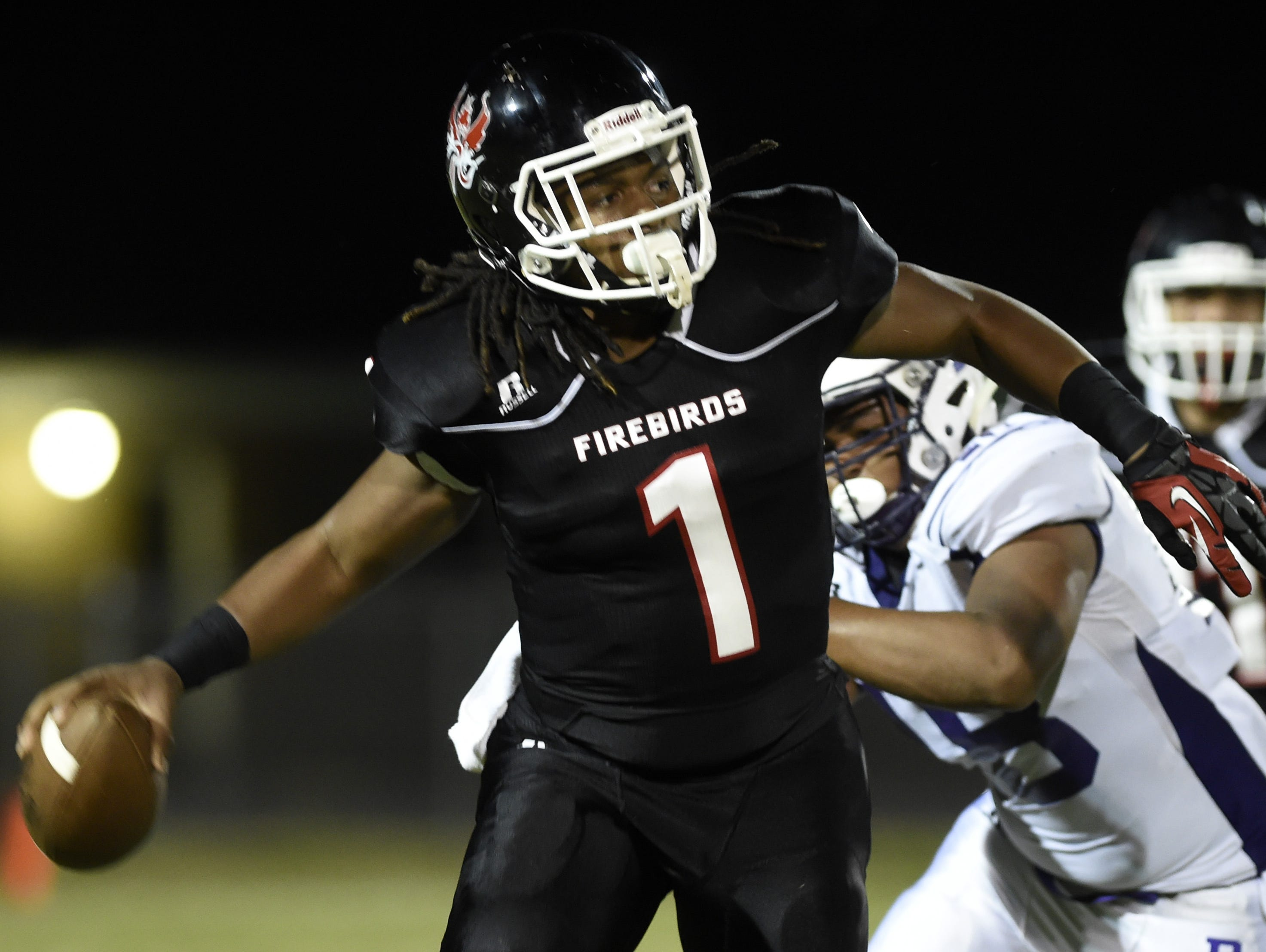 Pearl-Cohn quarterback Jimmy Ferrell (1) has thrown for 2,000 yards and 21 touchdowns this season.