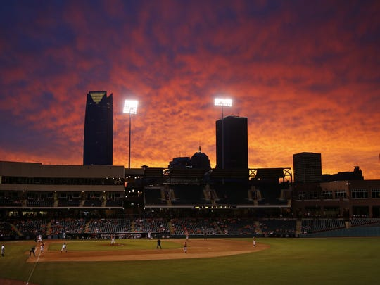The sun sets during a Big 12 Tournament baseball game between Oklahoma State University and the University of Texas at Chickasaw Bricktown Ballpark in Oklahoma City, Saturday, May 24, 2014. Photo by Bryan Terry The Oklahoman