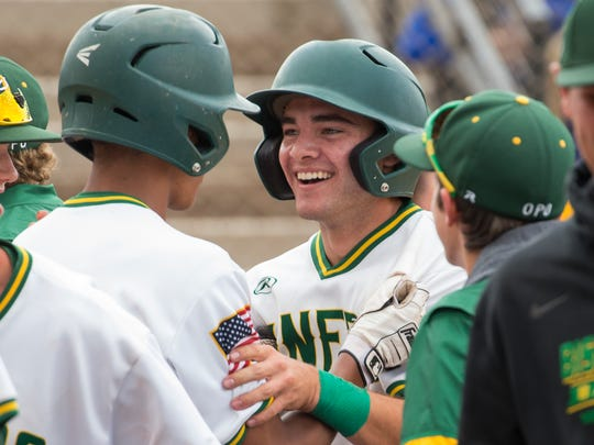 Manogue's CJ Hires, center, is congratulated by teammates
