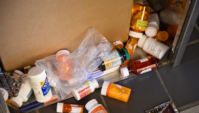 Prescription drugs overflow the turn-in box at the Stearns County Law Enforcement Center in Nov., 2016, in St. Cloud.