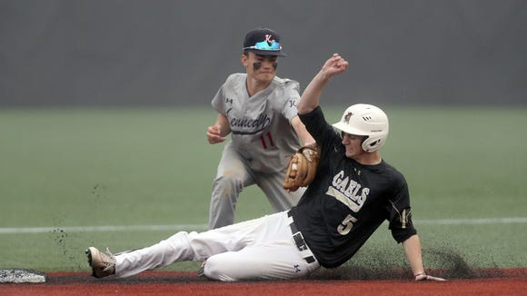 Iona Prep's Kevin Bomba (5) is tagged out at second by Kennedy Catholic's Zach Selinger (11) the CHSAA baseball playoff game at Fordham University in the Bronx on Thursday, May 31, 2018.