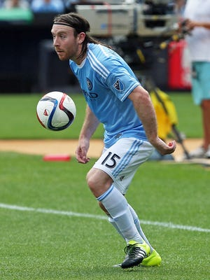 NYC FC's Thomas McNamara (15) moves the ball up the field against Montreal Impact during a soccer game at Yankee Stadium Aug. 1, 2015. The West Nyack native scored a goal in NYC FC's 3-2 loss.