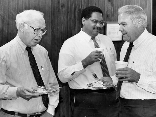 From left, Pensacola News Journal Editor J. Earle Bowden, Human Resources Director Jim Barnett and Publisher Kenneth W. Andrews attend a party honoring Bowden in the early 1990s.