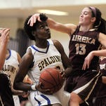 Spalding's Kayla Styles (center) is fouled by Eureka College's Emily Camden (13) as she drives to the basket on Saturday during the 2015 SLIAC Championship at Spalding University. Spalding won 80-50 and Styles was named MVP of the tournament. (By David Lee Hartlage, Special to the C-J) Feb. 28, 2015.