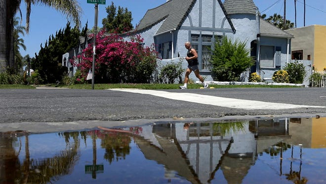 Californians conserved little water in March and local officials were not aggressive in cracking down on waste, state regulators reported Tuesday.