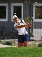 Augustana's Sierra Langlie practices hitting her ball out of a bunker before playing a round of golf Thursday, April 21, 2016, at Kuehn Golf Course in Sioux Falls.