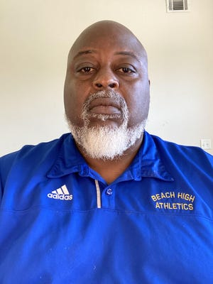 Corey Phillips is the new football coach at Beach High.